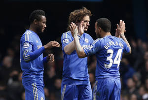 Photo - Chelsea's David Luiz, center, Ryan Bertrand, right, and John Obi Mikel react to their win against Manchester United at the end of their English FA Cup quarter final replay soccer match at Stamford Bridge, London, Monday, April 1, 2013. (AP Photo/Sang Tan)