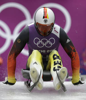 Photo - Felix Loch of Germany starts a run during a training session for the men's singles luge at the 2014 Winter Olympics Friday, Feb. 7, 2014, in Krasnaya Polyana, Russia. (AP Photo/Dita Alangkara)
