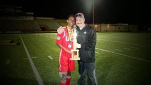 Photo - U.S. Grant soccer coach Stephen Cookson, left, with senior Fraol Legesse after the Generals won the Midwest City tournament this season. PHOTO PROVIDED <strong></strong>