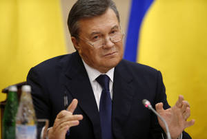 Photo - Ukraine's fugitive president Viktor Yanukovych speaks at a news conference in Rostov-on-Don, a city in southern Russia about 1,000 kilometers (600 miles) from Moscow, Friday, Feb. 28, 2014. Ukrainian fugitive president appears for first time since Saturday at Russia news conference. (AP Photo/Pavel Golovkin)