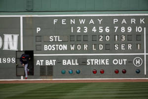 Photo - St. Louis Cardinals' Michael Wacha runs out of a scoreboard under the Green Monster before batting practice for Game 1 of baseball's World Series against the Boston Red Sox Tuesday, Oct. 22, 2013, in Boston. (AP Photo/David J. Phillip)