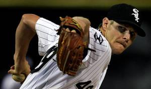 photo -   Chicago White Sox starting pitcher Chris Sale throws against the Cleveland Indians in the first inning during a baseball game, Monday, Sept. 24, 2012, in Chicago. (AP Photo/John Smierciak)