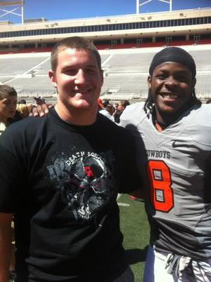 photo - Carl Albert's Caleb Holland with OSU's Daytawion Lowe, a former Carl Albert standout. PHOTO PROVIDED