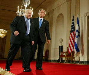 "Photo - FILE - In this Wednesday, April 14, 2004 file photo, President Bush, right, and Israeli Prime Minister Ariel Sharon, left, walk together at the end of a joint press conference in the Cross Hall of the White House in Washington. The son of former Israeli Prime Minister Ariel Sharon says his father has died on Saturday, Jan. 11, 2014. The 85-year-old Sharon had been in a coma since a debilitating stroke eight years ago. His son Gilad Sharon said: ""He has gone. He went when he decided to go.""  (AP Photo/Pablo Martinez Monsivais, File)"