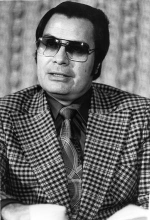 Photo - FILE - This Jan. 1976 photo shows the Rev. Jim Jones, pastor of peoples Temple in San Francisco.  The cremated remains of nine victims of a 1978 mass cult suicide-murder in Jonestown, Guyana, have turned up in a former funeral home in Delaware, officials said Thursday, Aug. 7, 2014. The state Division of Forensic Science has taken possession of the remains and is working to make identifications and notify relatives, the agency and Dover police said in a statement. On Nov. 18, 1978,  Jones orchestrated a ritual of mass murder and suicide in Jonestown, Guyana.  Bodies of 911 massacre victims were brought to Dover Air Force Base, home to the U.S. military's largest mortuary. Many of the bodies were decomposed and could not be identified.  (AP Photo/File)