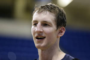 Photo - Charlotte Bobcats' Cody Zeller talks to the media after practice at NBA basketball training camp in Asheville, N.C., Wednesday, Oct. 2, 2013. (AP Photo/Chuck Burton)
