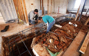 photo - Construction workers build a safe room for the city of Edmond's computer servers in a building recently  purchased at 1273 N Broadway. PHOTO BY JIM BECKEL, THE OKLAHOMAN