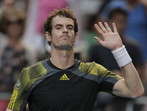 Photo - Britain's Andy Murray celebrates after defeating France's Gilles Simon in their fourth round match at the Australian Open tennis championship in Melbourne, Australia, Monday, Jan. 21, 2013. (AP Photo/Rob Griffith)