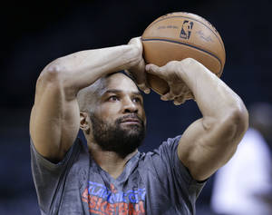 Photo - Oklahoma City Thunder guard Derek Fisher shoots during practice Friday, April 25, 2014, in Memphis, Tenn. The Thunder face the Memphis Grizzlies on Saturday in Game 4 of their opening-round NBA basketball playoff series. The Grizzlies lead the series 2-1. (AP Photo/Mark Humphrey)
