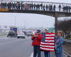 Photo - Supporters of Chris Kyle line up along the southbound lane of Interstate 35, Tuesday, Feb. 12, 2013, in Waco, Texas, for his final journey to Austin, where he will be buried at the Texas State Cemetery. Kyle and his friend Chad Littlefield were shot and killed Feb 2. at a North Texas gun range. (AP Photo/Waco Tribune Herald, Rod Aydelotte)
