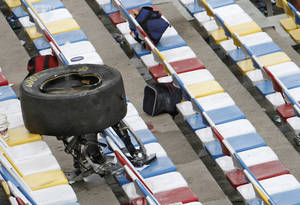 photo - A wheel, tire and suspension parts sit in the stands after crash on the final lap of the NASCAR Nationwide Series auto race Saturday, Feb. 23, 2013, at Daytona International Speedway in Daytona Beach, Fla. Several fans were injured when large chunks of debris sailed into the grandstands after a car flew into the fence. (AP Photo/David Graham)