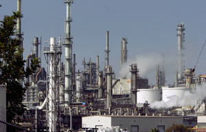 Photo -  The ConocoPhillips Los Angeles Refinery is seen in operation in California.  AP File Photo  <strong>Ric Francis</strong>