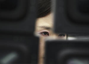 Photo - FILE - In this Tuesday, Feb. 4, 2014, file photo, A currency trader watches monitors at the Korea Exchange Bank headquarters in Seoul, South Korea.  The Treasury Department reports how much foreign buyers adjusted their holdings of U.S. debt in January on Tuesday, March 18, 2014. (AP Photo/Ahn Young-joon, File)