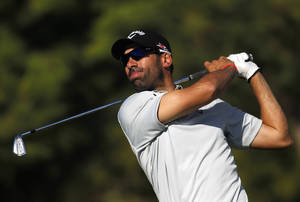 Photo - Alvaro Quiros, from Spain, plays a shot from the 16th tee during the first round of the Portugal Masters golf tournament at the Victoria golf course in Vilamoura, southern Portugal, Thursday, Oct. 10, 2013. (AP Photo/Francisco Seco)