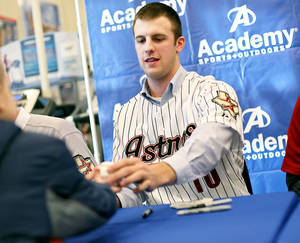 Photo - Jordan Lyles, a 20-year-old pitcher, signs autographs during the Astros caravan stop at Academy Sports and Outdoors in south Oklahoma City on Wednesday.  Photo by John Clanton, The Oklahoman