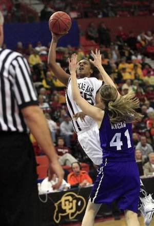 photo - Texas A&M guard Danielle Gant, left, shoots over Kansas State guard Kari Kincaid, right, in the second half of an NCAA college basketball game at the Big 12 Conference women's tournament in Oklahoma City, Friday, March 13, 2009.  Texas A&M won the game 65-63. (AP Photo/Sue Ogrocki)