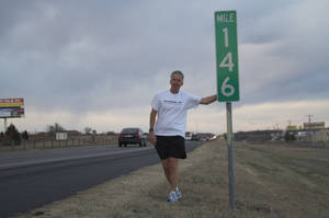 photo - Tom Pace, CEO of PaceButler Corp, pauses for a picture during his run across the state to promote literacy, mentoring and running. Photo provided