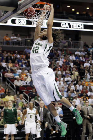 photo - FILE - In this March 24, 2012, file photo, Baylor center Brittney Griner dunks the ball during the second half of an NCAA women's tournament regional semifinal college basketball game against Georgia Tech in Des Moines, Iowa. President Barack Obama is going with Griner and Baylor to win back-to-back titles in the NCAA women's basketball tournament. Obama's pick was announced Friday, March 22, 2013 on ESPN.  (AP Photo/Charlie Neibergall, File)