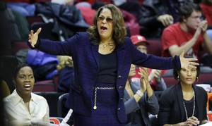 Photo - Rutgers coach C. Vivian Stringer reacts to play during the first half of her team's NCAA college basketball game against Louisville on Tuesday, Jan. 28, 2014, in Piscataway, N.J. Louisville won 80-71.(AP Photo/Mel Evans)
