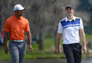 photo - Tiger Woods, left, and Justin Rose, of England, walk to their next shot on the fairway during the second round of the Arnold Palmer Invitational golf tournament, Friday, March 22, 2013, in Orlando, Fla. (AP Photo/Phelan M. Ebenhack)