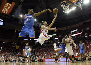 Photo - Houston Rockets' Chandler Parsons (25) goes up for a shot as Oklahoma City Thunder's Kevin Durant (35) defends during the third quarter of Game 4 in a first-round NBA basketball playoff series Monday, April 29, 2013, in Houston. The Rockets beat the Thunder 105-103. (AP Photo/David J. Phillip)