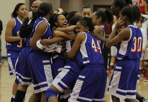 Photo - Millwood celebrates their win over Kansas during the semi final 3A girls State Basketball Championship game between Millwood High School and Kansas High School at Yukon High School on Friday, March 9, 2012 in Yukon, Okla.  Photo by Chris Landsberger, The Oklahoman