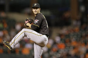 Photo - Pittsburgh Pirates starting pitcher Brandon Cumpton throws to the Baltimore Orioles in the fourth inning in the second baseball game of a doubleheader on Thursday, May 1, 2014, in Baltimore. (AP Photo/Patrick Semansky)