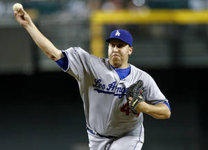 Photo -   Los Angeles Dodgers pitcher Aaron Harang delivers against the Arizona Diamondbacks during the first inning of a baseball game on Wednesday, Sept. 12, 2012,in Phoenix. (AP Photo/Matt York)