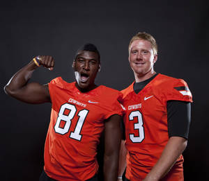 Photo - Oklahoma State's Brandon Weeden (3) and Justin Blackmon (81) pose a photo during Oklahoma State's Football media day in Stillwater, Okla., Saturday, Aug. 6, 2011. Photo by Sarah Phipps, The Oklahoman