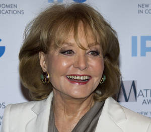 Photo - In this Monday, April 23, 2012 photo, veteran ABC newswoman Barbara Walters arrives to the Matrix Awards in New York. Walters has fallen at an inauguration party in Washington and has been hospitalized, according to an ABC News spokesman, Sunday, Jan. 20, 2013. (AP Photo/Charles Sykes)