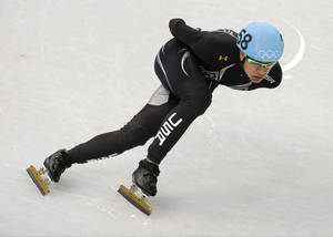 Photo - J.R. Celski of the United States competes in a men's 1000m short track speedskating heat at the Iceberg Skating Palace during the 2014 Winter Olympics, Thursday, Feb. 13, 2014, in Sochi, Russia. (AP Photo/Darron Cummings)