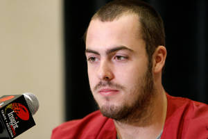 photo - OU / COLLEGE FOOTBALL: Oklahoma's Landry Jones (12) talks to the media during a University of Oklahoma media day for the Insight Bowl at the Camelback Inn in Paradise Valley, Ariz.,  Wednesday, Dec. 28, 2011. Photo by Sarah Phipps, The Oklahoman