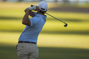Photo - Adam Scot, of Australia, follows his fairway shot on No. 13 during the first round of the Sony Open golf tournament, Thursday, Jan. 9, 2014, in Honolulu. (AP Photo/Marco Garcia)