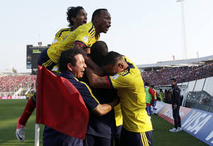 Photo -   Colombia's players celebrates a play during a World Cup 2014 qualifying soccer game with Chile in Santiago, Chile, Tuesday, Sept. 11, 2012. Colombia won 3-1. (AP Photo/Luis Hidalgo)