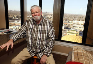 Photo - Wally Hunt, a construction manager who divides his time between Oklahoma City and Charlotte, N.C., was one of the first residents of The Classen, moving in in 2007. <strong>NATE BILLINGS - The Oklahoman</strong>