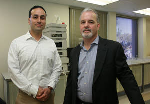 Photo - Sensulin co-founder Mike Moradi, left, and scientist Chris Rhodes hope to reduce the number of insulin injections type 1 diabetes patients need each day to regulate blood sugar from as many as seven to as few as one. Photo by Jim Stafford, For The Oklahoman