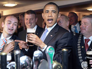Photo - U.S. President Barack Obama drinks a Guinness beer and meets with local residents Monday at Ollie Hayes pub in Moneygall, Ireland, the ancestral homeland of his great-great-great grandfather. Obama is beginning a four-nation European trip. AP PHOTO