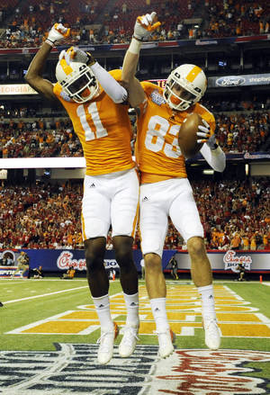 Photo -   Tennessee wide receiver Zach Rogers (83) celebrates his first quarter touchdown reception with teammate Justin Hunter (11) against North Carolina State in the Chick-fil-A Kickoff Game, beginning the NCAA college football season, in Atlanta., on Friday, Aug. 31, 2012. (AP Photo/John Amis)