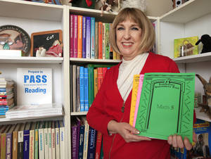 Photo -      Jan Barrick, chief executive of Alpha Plus Educational Systems Inc., displays some of the course curriculum she's written. Photo by Paul B. Southerland, The Oklahoman  <strong>PAUL B. SOUTHERLAND -  PAUL B. SOUTHERLAND </strong>