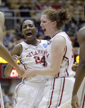 Photo - Oklahoma's Sharane Campbell, left, and Joanna McFarland celebrate during the second half of a first-round game against Central Michigan in the women's NCAA college basketball tournament Saturday, March 23, 2013, in Columbus, Ohio. Oklahoma beat Central Michigan 78-73. (AP Photo/Jay LaPrete) ORG XMIT: OHJL109