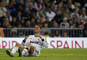 Photo -   Real Madrid's Cristiano Ronaldo from Portugal reacts during a Spanish La Liga soccer match against Celta at the Santiago Bernabeu stadium in Madrid, Spain, Saturday, Oct. 20, 2012. (AP Photo/Andres Kudacki)