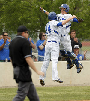 Photo - Noble's Braden Buol (14) and Trevor Lester (4) celebrate after Buol scored during a Class 5A high school baseball game between Deer Creek and Noble in the state tournament at Edmond Santa Fe in Edmond, Okla.,  Thursday, May 9, 2013. Photo by Nate Billings, The Oklahoman