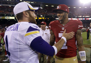 Photo - San Francisco 49ers quarterback Colin Kaepernick (7) talks with Minnesota Vikings quarterback McLeod Bethel-Thompson (4) after an NFL preseason football game in San Francisco, Sunday, Aug. 25, 2013. The 49ers won 34-14. (AP Photo/Marcio Jose Sanchez)