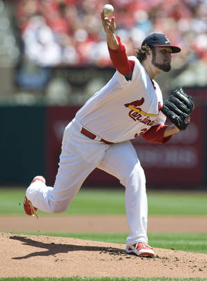 Photo -   St. Louis Cardinals starting pitcher Lance Lynn throws during the first inning of a baseball game against the Atlanta Braves on Sunday, May 13, 2012, in St. Louis. (AP Photo/Jeff Curry)