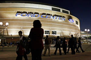 photo - People walk outside the Ford Center during Opening Night New Year's Eve activities in Oklahoma City on Thursday, December 31, 2009. Photo by Bryan Terry, The Oklahoman ORG XMIT: KOD