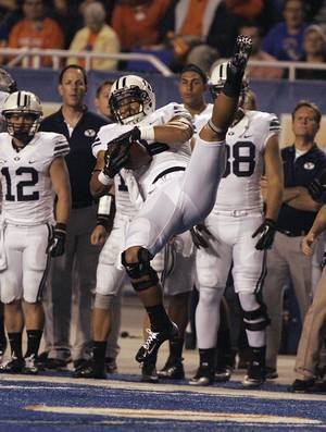 photo -   Brigham Young's Richard Wilson (18) makes a reception against Boise State during the second half of the college football game on Thursday, Sept. 20, 2012 in Boise, Idaho. (AP Photo/Matt Cilley)