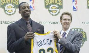 Photo - Thunder general manager Sam Presti got a little emotional talking about Jeff Green, who Presti traded to the Boston Celtics on Thursday. Presti is shown here presenting Green his jersey before his rookie season. AP PHOTO <strong>John Froschauer</strong>
