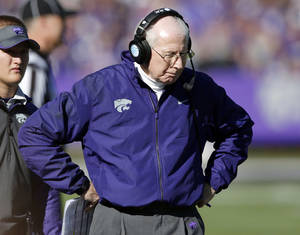 Photo - Kansas State coach Bill Snyder walks the sidelines during the first half of an NCAA college football game against West Virginia in Manhattan, Kan., Saturday, Oct. 26, 2013. (AP Photo/Orlin Wagner)