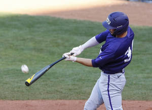 Photo - TCU's Garrett Crain gets a hit in the eighth inning of a second-round game against TCU in the Big 12 conference NCAA college baseball tournament in Oklahoma City, Thursday, May 22, 2014. (AP Photo/Alonzo Adams)