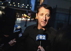 Photo - In this photo taken on Oct. 28, 2013, television infomercial pitchman Kevin Trudeau speaks to the media after leaving the Metropolitan Correctional Center in downtown Chicago. On Tuesday, Nov. 12, 2013, Trudeau's attorney and government attorneys began delivering closing arguments in his criminal contempt trial, after federal prosecutors spent nearly a week trying to prove the TV pitchman made false claims about his best-selling diet book. (AP Photo/Sun-Times Media, Michael Jarecki) MANDATORY CREDIT, MAGS OUT